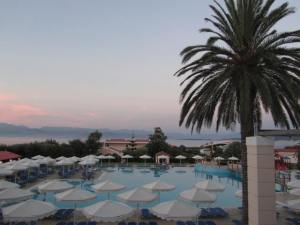 Overlooking the main pool area and beyond that the sea