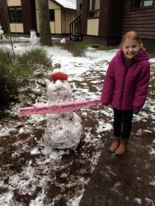 Birthday girl and her snowman