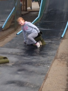 Braving the slide for the first time